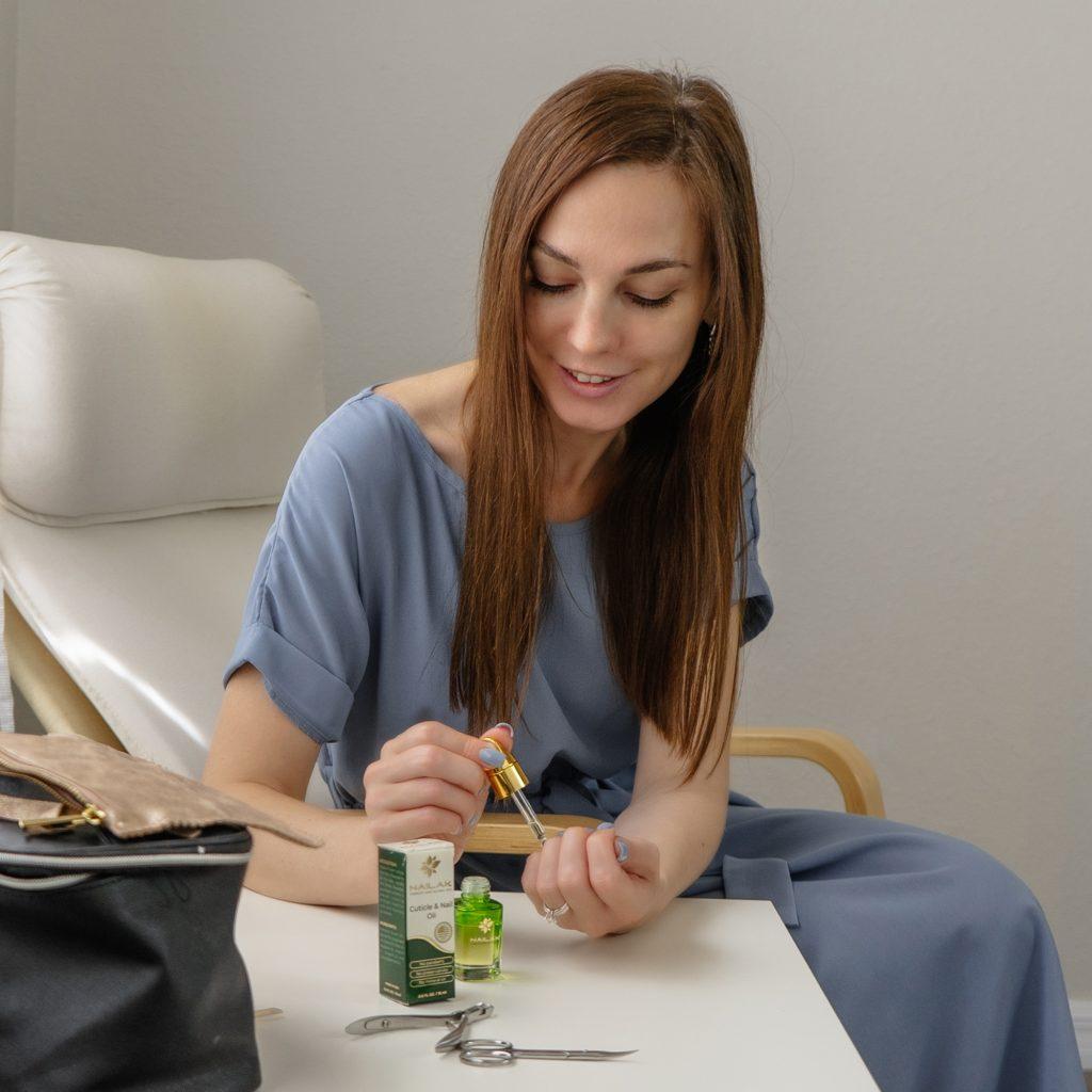 Nailak nail cuticle oil with model